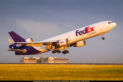 """CDG.2009 # FX MD11F N601FE """"First MD11 built"""" awp (CHR / AeroWorldpictures Team) Tags: federal express fedex mcdonnell douglas md11f cn 48401 447 engines 3x ge cf680c2d1f aircraft name jimriedmeye reg n601fe history 10jan1990 first flight test n111md long beach lgb ca usa 27jun1991 delivered federalexpress fx fdx config cargo takeoff sunset climb mdc md11 gear nikon d80 zoomlenses nikkor 70300vr raw lightroom paris cdg lfpg france roissy charlesdegaulle prototype firstmd11"""