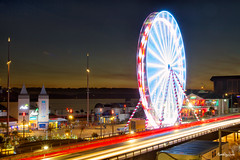 Movement of the Wheel by Bournemouth Pier (mpelleymounter) Tags: bournemouth bournemouthpier bournemouthseafront pier wheel ferriswheel visitbournemouth sunset sky road traffic movement light lighttrails traffictrails markpelleymounter dorsetlandscape dorsetnightsky dorsetseascape