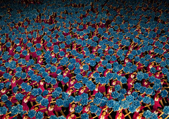 MOUVEMENT DE MASSE ARIRANG A PYONGYANG, COREE DU NORD (Eric Lafforgue Photography) Tags: show blue color colour asia day outdoor stadium propaganda politics capital performance dancer bleu celebration asie capitale awe couleur stade northkorea axisofevil pyongyang spectacle dictatorship occupation dprk stalinist danseuse arirang capitalcities traveldestinations exterieur dictature traveldestination democraticpeoplesrepublicofkorea massgames maydaystadium dpkr encouleur coreedunord axedumal rdpc massgame massmouvement mouvementdemasse