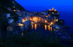 Night Harbor   ~DUSK @ Vernazza of the Cinque Terre () ~ (PS~~) Tags: ocean santa blue summer vacation sky italy sun holiday seascape streets color church water colors rock stone landscape coast harbor boat town fishing colorful aqua mediterranean sailing ship turquoise liguria terraces shoreline azure tourist medieval cliffs quay unesco seacliff terre towels cinqueterre nightview mountainside traveling charming hillside vernazza quaint viewpoint picturesque manarola cosy cinque buidling adriatic riomaggiore italianriviera fishingvillage alleys delights italianvillage cultivated fishingharbor bustling fishingport almare fivevillages sceniclandscapes doriacastle monterosse nightscenic churchofsantamargheritadantiochia nationalparkcinqueterre