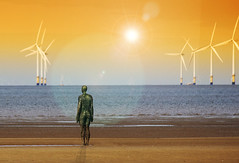 Power Commander at Another Place (Gill Stafford) Tags: sculpture man color colour statue liverpool naked nude image wind estuary photograph anthony sands turbine mersey windfarm gormley crosby merseyside anotherplace gillstafford