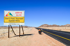 Cycling in Northern Cape, South Africa (jbdodane) Tags: africa road bicycle sign southafrica cycling safety velo cyclotourisme namaqualand northerncape cycletouring namakwaland alamy day651 freewheelycom alamy141014