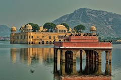 Jal Mahal (Water Palace) (usaid.d800) Tags: travel light india mountain lake man color reflection building tree history nature water colors architecture century photography amber ancient nikon day arch exterior place image fort famous hill style tranquility mahal landmark 18th palace surface structure national rippled majestic jaipur built jal rajasthan amer sagar destinations northindia travelphotography indianculture aravalli incredibleindia beautifulindia lakemansagar discoverindia d7000 24120mmf4