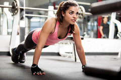 Cute brunette working out at a gym (tigercop2k3) Tags: portrait people woman cute girl beautiful sport female training mexico concentration outfit athletic exercise body muscle spirit chest lifestyle indoor health gloves latin strong strength hispanic pushups copyspace brunette workout fitness youngadult gym focused weightloss fit sporty active gymnastic 20s sportswear