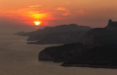 Orange sunset... (Yin*Yang) Tags: travel sunset sky orange cloud seascape france water canon landscape eos gold marseille postcard ngc fine shoreline 5d cassis calanques littoral flickrelite pwpartlycloudy