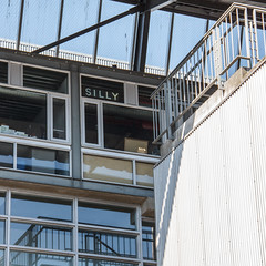 Silly (WalrusTexas) Tags: shadow sky urban reflection geometric monochrome architecture vancouver cyan diagonal efs18135mmf3556is