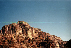 34-679 (ndpa / s. lundeen, archivist) Tags: nick dewolf nickdewolf color photographbynickdewolf 1970s 1973 film 35mm 34 reel34 arizona northernarizona southwesternunitedstates grandcanyon coloradoriver raftingtrip raftingexpedition mountains canyonwalls rock rocks rocky terrain landscape scratch scratches scratched sky bluesky 1972
