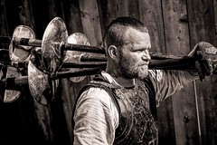The Spear Carrier (Wes Iversen) Tags: fencefriday hff holly michigan michiganrenaissancefestival nikkor18300mm blackandwhite fence fences men monochrome people spears portraits