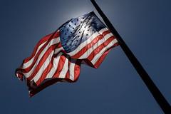...with liberty and justice for all. (Karen Carmen) Tags: usa flag halfmast starspangledbanner libertyisland america americanflag flagpole liberty