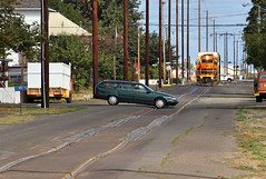Watch those dips (Moffat Road) Tags: portlandandwestern pnwr americanturn localfreight 2307 emd gp392 oe oregonelectric oedistrict streettrackage streetrunning harrisburg oregon train railroad locomotive or fordtaurus car stationwagon formerinterurban
