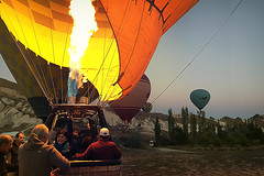 Excitement (Melissa Maples) Tags: greme turkey trkiye asia  apple iphone iphone6 cameraphone kapadokya cappadocia dawn morning autumn hotairballoons balloons couple beate frank basket flame fire greme trkiye