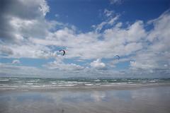 Windsurfers (bakey_) Tags: beach clouds sky windsurfers