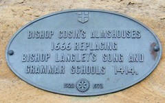 Durham - alms houses plaque (rossendale2016) Tags: emblem high screwed screws secured shield oval door over wall metal lead 1973 1923 schools grammar song langleys crossing bishop replacing 1414 1666 plaque houses alms durham round table rotary charity bishops