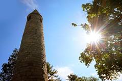 Irish Round Tower - Milford, MA (2) (t55z) Tags: sun tower massachusetts lensflare granite miflord irishroundtower