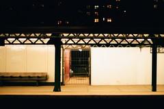 waiting at 215th street (september.) Tags: nyc newyorkcity light film station night 35mm subway waiting manhattan broadway canonae1 1train inwood nycsubway canonfd50mmf14 canonfd kodakportra400 elevatedsubway 215thstreet