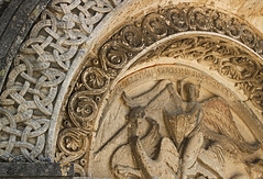 Tympanum St Michel Angouleme (Lark Ascending) Tags: france church stone carving norman stmichel romanesque eglise charente angouleme tympanum aquitaine 12thc octagonalchurch stmichaelslayingthedragon