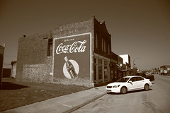 Route 66 - Coca Cola Ghost Mural (Frank Footer Fotos) Tags: road trip travel red vacation sky usa sun white black west building art classic oklahoma home sunshine wall architecture rural america vintage advertising photography freedom town office bottle mural midwest cola drink framed small bricks country rustic fine ad mother murals sunny coke roadtrip pop 66 historic retro adventure business route nostalgia posters buy prints americana kicks motor roadside stroud ok decor coca rt attractions