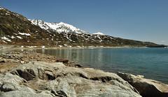 spluga lake (Mario Barzionni) Tags: lake fish snow ski mountains ice water rock lago fishing cielo pesci neve rod roccia acqua alpi pesca montagna canna ghiaccio spluga alpino
