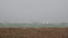 Sailboards in the rain (fstop186) Tags: sea sky storm abstract beach window water glass rain reflections pattern random stones poor windshield heavy windscreen refractions visibility torrential sailboards