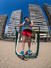 Holiday Exercise. (CWhatPhotos) Tags: exercise keeping fit walking machine walk sky scraper hotels hotel benidorm spain spanish resort costa blanca photographs photograph pics pictures pic picture image images foto fotos photography artistic cwhatphotos that have which with contain epl5 olympus esystem four thirds digital camera lens olympusepl5 43 mft micro seaside holiday september 2014 beach front sand coast people group samyang 75mm manual focus fish eye fisheye wide angle flickr