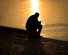 Missing the sunset (Bhavishya Goel) Tags: sunset silhouette gteborg technology phone sweden gothenburg goldenlight lillabommen