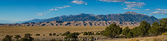 Great Sand Dunes National Park and Preserve Panorama (Mike Ver Sprill - Milky Way Mike) Tags: greatsanddunesnationalpark colorado landscape beautiful greatsandduneslodge hotel 85mm18g pano panorama bushes sand co mountains mountainrange nature amazing unique travel explore mikeversprill michaelversprill
