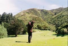 Drive with a View (Denzel De Ruysscher) Tags: 35mm pentax colour film explore golf green nature sun sky windmill