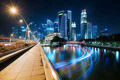 All that glitters (Scintt) Tags: singapore marina bay long exposure slow shutter night sony 17mm tse tilt shift canon perspective correction wide angle glow light colourful skyline city cityscape structure skyscrapers vantage point buildings architecture cbd central business district financial centre hotels fullerton expensive exquisite shopping road lines trails evening travel tourism urban modern exploration boat river water reflection sky blue jon chiang photography scintillation scintt multiple layers starburst flare lens