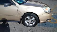 Rippled Malibu Fender (artistmac) Tags: chicago il illinois city urban street chevrolet chevy malibu rippled fender door gold car automobile auto american gm generalmotors