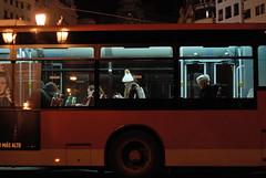 The night cap (Riccardo Mori) Tags: valencia nikon d200 night bus people girl lamp building glass red type window olympus