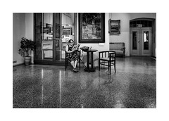 Alone in the gallery (Jan Dobrovsky) Tags: bw city contrast document gallery grain indoor leicaq people prague