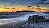 Dyrhólaey from Reynisfjara, the Black Sands Beach (BitRogue) Tags: nikon d800 iceland winter capturenx2 reynisdrangar víkímýrdal dyrhólaey dyrhólaeylighthouse 50mm sunset goldenhour sea silhouette evening reynisfjara black sand beach