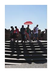 A Dominating Landmark (icypics) Tags: colour czechrepublic prague praguecastle streetphotography leadinglines red shadows steps symmetry tourists umbrella