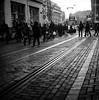Winter stroll (Nobusuma) Tags: homemadesoup hasselblad500cm hasselblad 500cm zeissplanar zeiss planar 80mm f28 mediumformat medioformato 120 6x6 ilford panf ilfordpanf 50iso selfdeveloped developedathome caffenolc streetphotography street tram sunset netherlands amsterdam winter