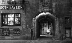 I hear long silenced footsteps echoing through these lanes. (lunaryuna) Tags: scotland edinburgh capital urban city history architecture building street close oldtolboothwynd lifeiscontinuity walkinthecity urbanconstruct stonewalls passage night nightlights nightphotography nocturnalphotography citynights blackwhite bw monochrome lunaryuna