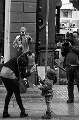 Bubbles, Clowns and Ice Cream (basselal) Tags: street camera bw woman men turkey kid child clown streetphotography bubbles istanbul icecream istiklal turkish sigma30mmf14exdchsm 100xthe2014edition 100x2014 image18100