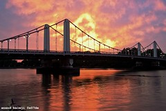 Fire in the sky... (Anand Balaji) Tags: bridge sunset summer london thames clouds river chelsea southbank wandsworth fiery scatteredclouds