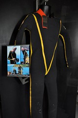 Cousteau vintage scuba wetsuit with yellow striping (Vintage Scuba) Tags: two man black men wet water yellow fetish vintage silver one us divers aqua mask under scuba diving rubber suit mans mens diver piece jacques striped drysuit fins wetsuit breathing lung aparatus neoprene