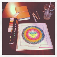 """Mandala coloring and journaling at my favorite coffee shop. I haven't done this in ages...don't forget to take yourself on an Art Date! This mandala is about a rainbow Hindu goddess who """"calls attention to the peaceful feeling of completing a creative pro (Samie Harding) Tags: square squareformat 1977 iphoneography instagramapp uploaded:by=instagram foursquare:venue=4a3956faf964a5205b9f1fe3"""