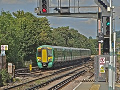 Green Leads Purple (Deepgreen2009) Tags: electric train fcc brighton purple fast railway southern purley 377 liveries