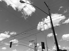 sky traffic (Star Tornero Photography (LaikazEyes)) Tags: street light arizona sky bw electric clouds turn phone traffic tucson telephone cell az pole cables monsoon fullframe signal uncropped 22nd 20140824115729 laikazeyes