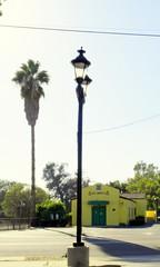 San Dimas iconic train depot (N@ncyN@nce) Tags: california railroad station yellow architecture train vanishingpoint 1930s perspective socal lamppost palmtree depot sandimas losangelescounty sangabrielvalley artsandcraftsera