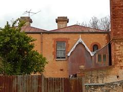Metal, Stone and Brick (mikecogh) Tags: old metal back rust sandstone rear worn chimneys northadelaide redbrick