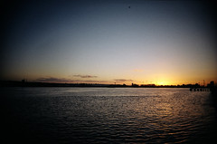 Fade to black (tripowski) Tags: blue winter sunset sky orange sun london film water thames river gold kodak 200 docklands ultrawide vivitar vignette uws kodakgold kodakgold200 gold200 ultrawideandslim