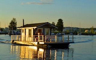 Floating sauna in evening sunlight
