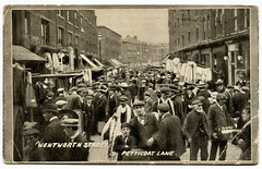 Petticoat Lane, London, postcard (circa 1912) (The Wright Archive) Tags: wentworth street petticoat lane london postcard vintage photograph market 1912 working class poor people crowd londonstreet uk old photo londonscene social history mrs schaefer clerkenwell a nicholl lawton douglas isleofman