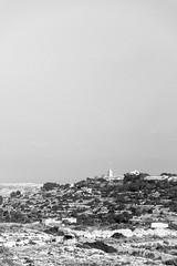 Bigger than the structure (lorenzoviolone) Tags: agfascala200 bw blackwhite blackandwhite d5200 dslr hill landscape monochrome nikon nikond5200 reflex vsco vscofilm church clearsky cross sky streetphoto streetphotobw streetphotography travel:malta=aug2016 addingli malta