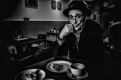 In a London Cafe (sophie_merlo) Tags: model man male guy dark moody grain cafe restaurant london bw blackandwhite noir mono monochrome hat glasses lonely sadness depression life feelings