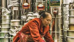Tibet, candid shot of a street vendor at the market (China), 06-2016, 78 (Vlad Meytin, vladsm.com) (Vlad Meytin   Instagram: vmwelt) Tags: chengguan china khimporiumco meytin tibet tibetan vladmeytin art artgallery artists artphoto artworld asia candid carlzeiss chinese fe5518 gallery highaltitude kitchenware local market oldwoman pans photography photographyart pictures sony sonya7 sonyalpha street streetphotography streetseller summer vendor vladsm vladsmcom vmwelt woman zeiss