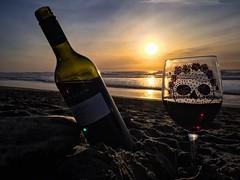 Sippin' on Sunset (BenitaMarquez) Tags: one single solo shiraz vintner outdoor outside waves sand redwine australian mcphersonvineyards dusk shadow silhouette sugarskull skull wineglass wine usa california sanfrancisco oceanbeach beach sunset